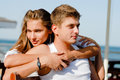 Young couple men women loving each other sea ocean Stock Photography