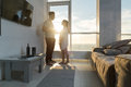 Young Couple Modern Apartment Big Panoramic Window Sea View, Mix Race Man And Woman Morning Bedroom Royalty Free Stock Photo