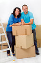 Young couple moving smiling at new home Royalty Free Stock Images
