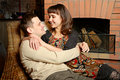 Young couple near fireplace Stock Photos