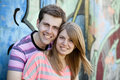Young couple near graffiti background. Stock Photo