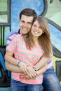 Young couple near graffiti background. Royalty Free Stock Photo