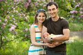 Young couple with newborn son outdoors in spring caucasian Royalty Free Stock Photography