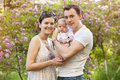 Young couple with newborn son in spring outdoors Stock Photography