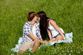 Young couple outdoor in summer on blanket Royalty Free Stock Images