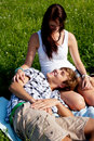 Young couple outdoor in summer on blanket Royalty Free Stock Photography
