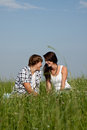 Young couple outdoor in summer on blanket Stock Photography