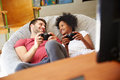 Young Couple In Pajamas Playing Video Game Together