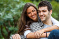 Young couple in park close up portrait of brunette and her boyfriend Stock Image