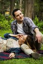 Young couple in park lying on grass Royalty Free Stock Photos