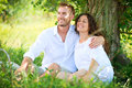 Young couple in a park picnic having happy family outdoor Royalty Free Stock Photos