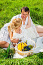 Young couple on picnic happy making in the park Royalty Free Stock Image