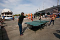 Young couple playing table tennis on a street culture festival kiev ukraine the banks of dnieper river kiev is th largest city Royalty Free Stock Image