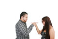 Young couple pointing at each other against a white background Stock Photo