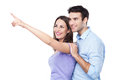 Young couple pointing over white background Royalty Free Stock Photo