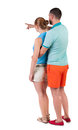 Young couple pointing in shorts and t shirt back view rear view people collection backside view of person isolated over white Royalty Free Stock Photos