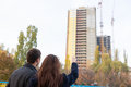 Young Couple Pointing Up at High Rise Building Royalty Free Stock Photo