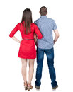 Young couple pointing at wal back view woman and man looking into the distance rear view people collection backside view of person Stock Photo