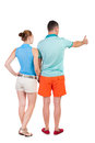 Young couple pointing at wal back view woman and man rear people collection backside of person isolated over white Stock Images