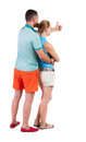 Young couple pointing at wal back view woman and man rear people collection backside of person isolated over white Royalty Free Stock Images