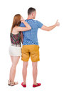 Young couple pointing at wal back view woman and man rear people collection backside of person isolated over white Stock Photo