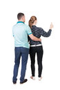 Young couple pointing at wal back view woman and man rear people collection backside of person isolated over white Royalty Free Stock Photo