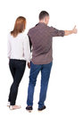 Young couple pointing at wal back view woman and man rear people collection backside of person isolated over white Stock Image