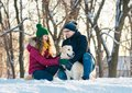 Young couple portrait with dog in winter