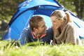 Young couple posing outside of tent Royalty Free Stock Images