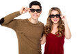Young couple posing to camera with shades on attractive smiling adjusting their goggles Royalty Free Stock Photo