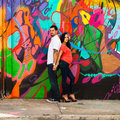 Young couple pregnant in a downtown urban setting Royalty Free Stock Images
