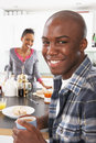 Young Couple Preparing Breakfast In Modern Kitchen Stock Photo