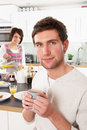 Young Couple Preparing Breakfast In Modern Kitchen Stock Image