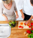Young couple preparing food in a kitchen Stock Images
