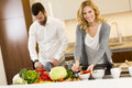 Young couple preparing meal in the kitchen Royalty Free Stock Photo