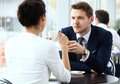 Young couple of professionals chatting during a coffeebreak coffee break Royalty Free Stock Photo