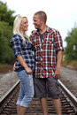 Young Couple on railroad tracks Stock Image