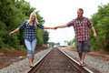 Young Couple on railroad tracks Royalty Free Stock Image