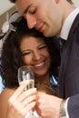 Young couple raising wedding toast Stock Photo