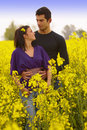 Young Couple in the Rape Field Royalty Free Stock Photo