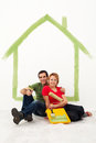 Young couple redecorating their first home together Royalty Free Stock Photos