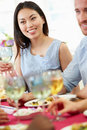 Young couple relaxing at dinner party having a good time smiling Stock Photos