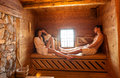 Young couple relaxing in a hot sauna Stock Photo