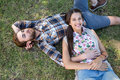 Young couple relaxing in the park smiling at camera on a summers day Royalty Free Stock Photos