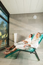 Young couple relaxing in wellness spa on liege they enjoy the sun Stock Photo