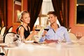 Young couple in a restaurant beautiful with glasses of wine Stock Photos