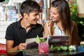 Young couple with restaurant menu at table close up portrait of dining out in Stock Photo