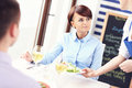Young couple in a restaurant picture of sitting and being served Stock Photography
