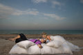 Young couple resting in bed beautiful morning on the beach Royalty Free Stock Image