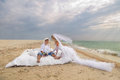 Young couple resting in bed beautiful morning on the beach Royalty Free Stock Photos